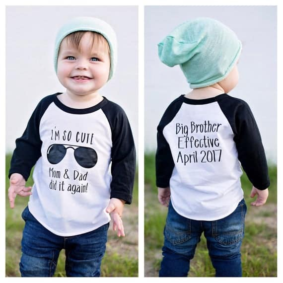 "Cute Pregnancy Announcement Shirts for sibling that says ""I'm so cute Mom and Dad did it again"" on the front with due date of new sibling on back"